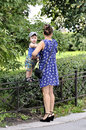 Mother holds little child stay on a garden protection who Stock Images