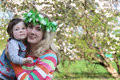 Mother hugging cheek to cheek baby girl in spring Royalty Free Stock Photos