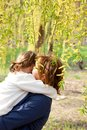 Mother hugging her daughter Stock Photography