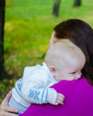 Mother hugs her baby in the park Royalty Free Stock Photo