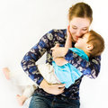 Mother Hugs Sleeping Baby Royalty Free Stock Photo