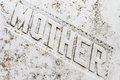 Mother inscription on old grunge marble tombstone Royalty Free Stock Image