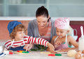 Mother Interacting with Children in Kitchen Royalty Free Stock Photos