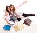 Mother joking with her daughter at homework isolated image of a during an exam preparation Stock Image
