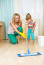 Mother and kid clean room having fun Royalty Free Stock Photography