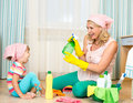 Mother with kid cleaning room and having fun girl Royalty Free Stock Images