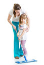 Mother and kid cleaninng room girl clean Royalty Free Stock Image