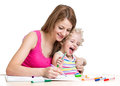 Mother and kid draw together painting Stock Images