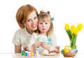 Mother and kid girl paint Easter eggs Royalty Free Stock Image