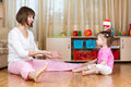 Mother and kid play with ball indoors toy Royalty Free Stock Images