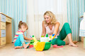 Mother and kid ready to room cleaning her daughter Stock Photo