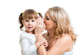Mother and kid sharing a secret whispering girl Royalty Free Stock Photo