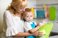 Mother And Kid Son Washing Dishes Royalty Free Stock Photo
