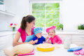 Mother and kids baking a pie Royalty Free Stock Photo