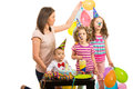 Mother and kids at birthday party their toddler boy against white background Royalty Free Stock Images