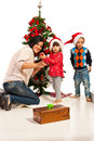 Mother with kids decorate tree christmas in their home Royalty Free Stock Photography