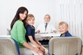 Mother with kids at doctors office Stock Image