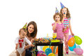 Mother and kids party having celebrate boy first birthday toddler trying to catch soap bubbles Royalty Free Stock Photography