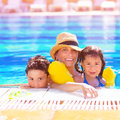 Mother with kids in poolside closeup portrait of young arabic two adorable children swimming the pool happy family on beach resort Stock Photography
