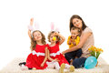 Mother and kids prepare for easter three holiday sitting together on carpet Stock Photo