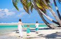 Mother and kids on a tropical beach Royalty Free Stock Photography