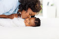 Mother kissing daughter caring african american her Royalty Free Stock Photography