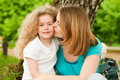 Mother kissing her daughter Royalty Free Stock Photos