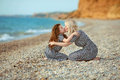 Mother kissing her daughter on the beach. outdoor family portrai Royalty Free Stock Photo