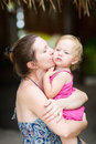 Mother kissing her little daughter Royalty Free Stock Photo