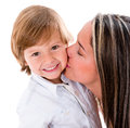 Mother kissing her son Royalty Free Stock Photo