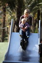 Mother and liitle daughter on slide Stock Photo