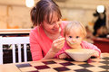 Mother and little baby eating in restaurant Royalty Free Stock Photo