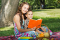 Mother and little boy reading book together Royalty Free Stock Images