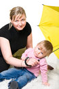 Mother and little child under umbrella Royalty Free Stock Photography