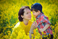 Mother and little child on yellow meadow Stock Photo