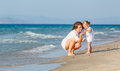 Mother with little daughter on the beach Stock Photography