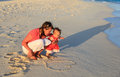 Mother and little daughter fun on the beach Royalty Free Stock Photo
