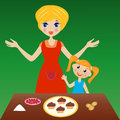 Mother with little daughter prepare delicious cake Stock Images