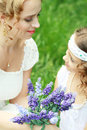 Mother and little daughter smiling on nature happy people outdoors copyspace Royalty Free Stock Photography