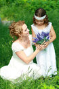 Mother and little daughter smiling on nature happy people outdoors copyspace Stock Photography