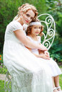 Mother and little daughter smiling on nature happy people outdoors th century style focus on Royalty Free Stock Image