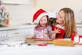 Mother and little kid girl baking gingerbread cookies for Christmas Royalty Free Stock Photo