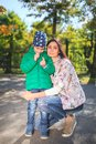 Mother and little son in an autumn park outdoors. Royalty Free Stock Photo