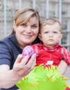 Mother and little toddler son on Easter with focus on egg Stock Photo