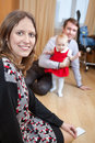 Mother looking at camera while father playing with baby girl in domestic room Royalty Free Stock Photo