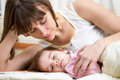Mother looking at sleeping kid girl Stock Images