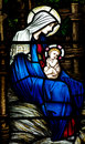 Mother Mary with baby Jesus (Nativity) in stained glass Royalty Free Stock Photo