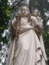 Mother mary and baby jesus statue of the virgin with rosary in one hand in the other Royalty Free Stock Image