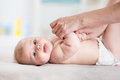 Mother massaging her baby girl Royalty Free Stock Photo