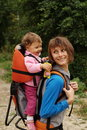 Mother mom with baby hiking Stock Images